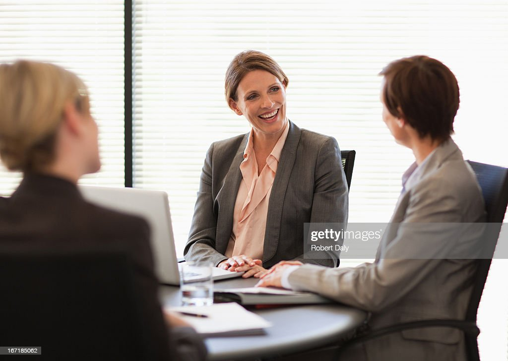 Smiling businesswomen with laptop meeting in conference room : Stock Photo