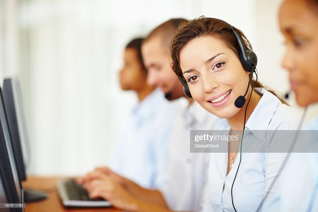 smiling headset-wearing employee