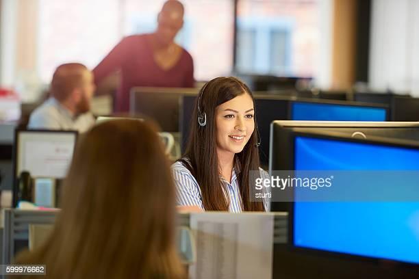 smiling call centre operative