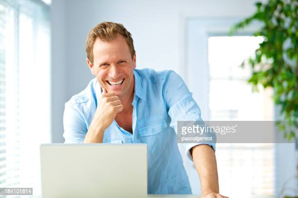 smiling casual businessman looking at the camera