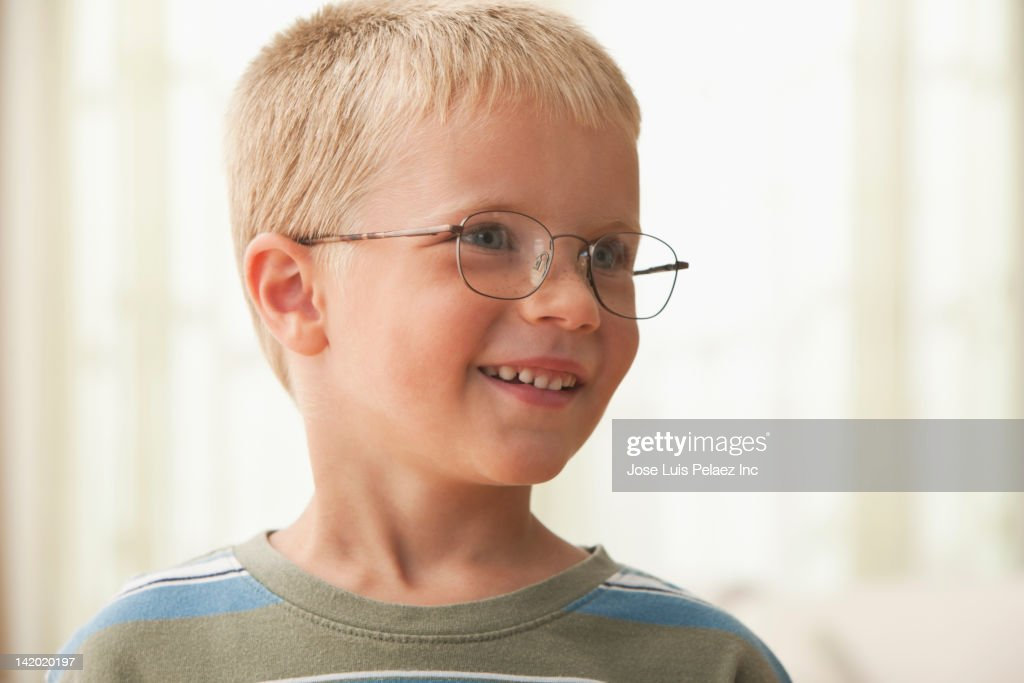 Smiling Caucasian boy in eyeglasses : Stock Photo