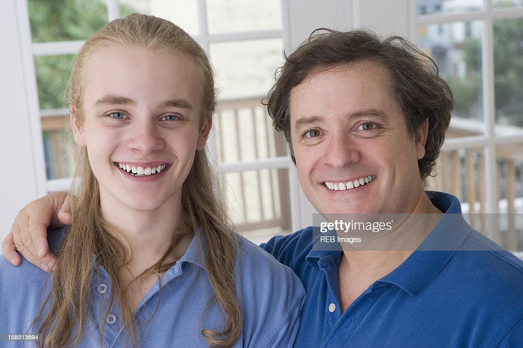 Smiling Caucasian father and son : Stock Photo