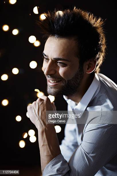 Smiling Caucasian man with beard at night