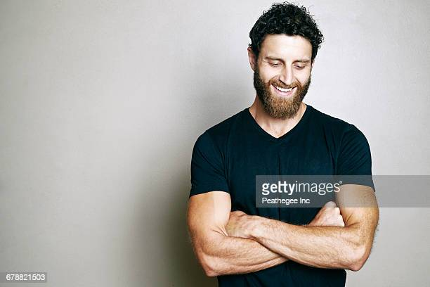 Smiling Caucasian man with beard looking down
