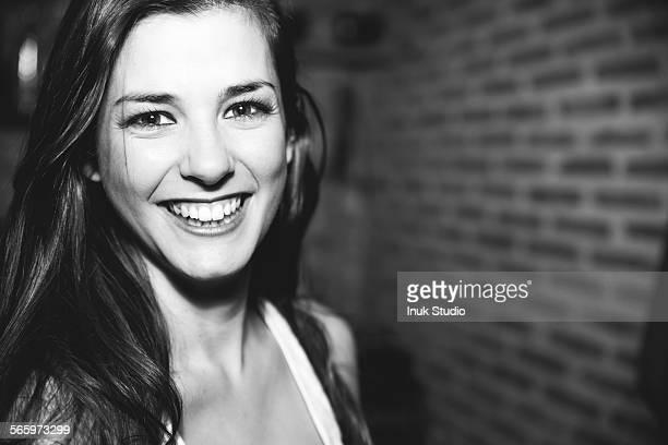 Smiling Caucasian woman laughing in nightclub