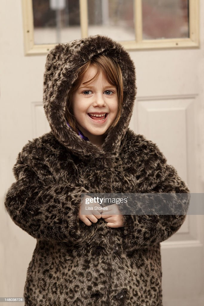 Smiling cheetah girl : Stock Photo