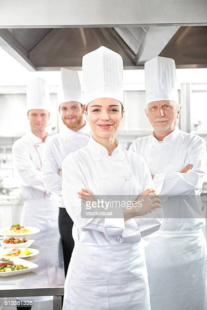 Smiling chefs looking at camera