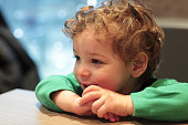 Portrait of smiling child at table in cafe