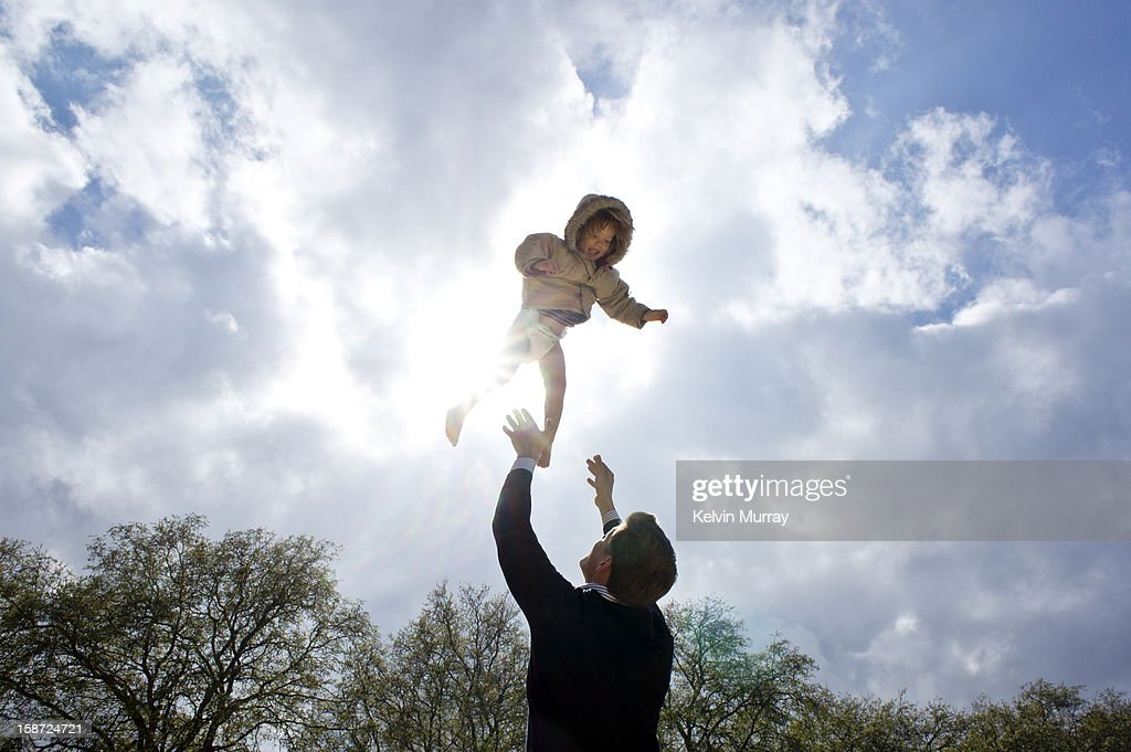Smiling child flying in the sun