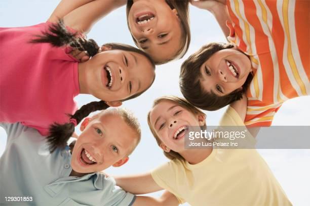 Smiling children huddling together