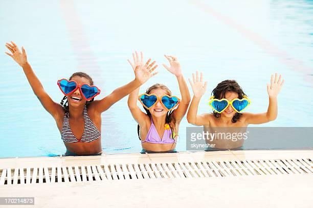 Smiling children in pool.