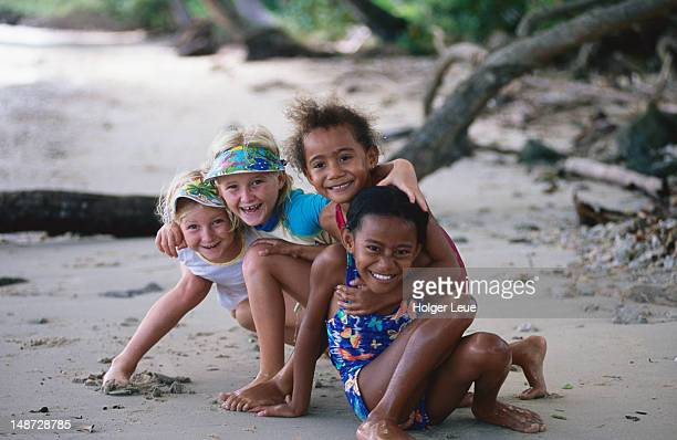 Smiling children on beach, Jean-Michel Cousteau resort, near Savusavu.