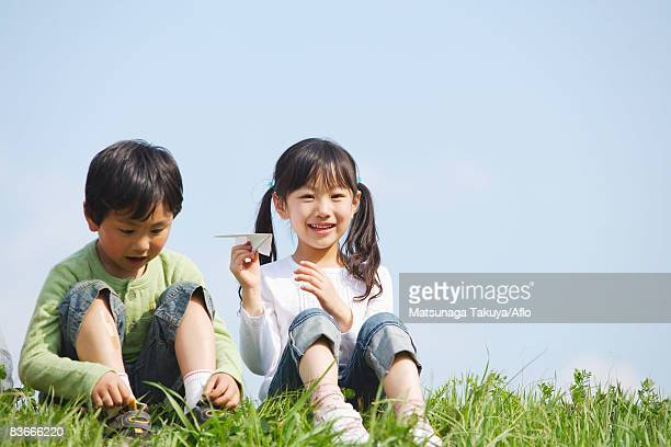 Smiling children playing in park together