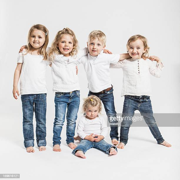 Smiling children posing together