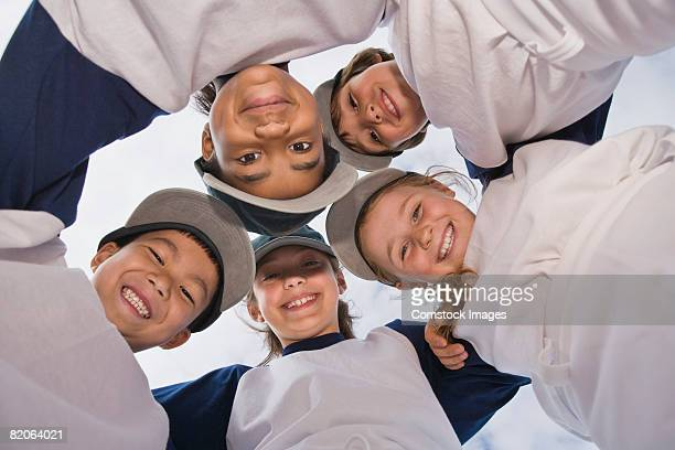 Smiling children's baseball team