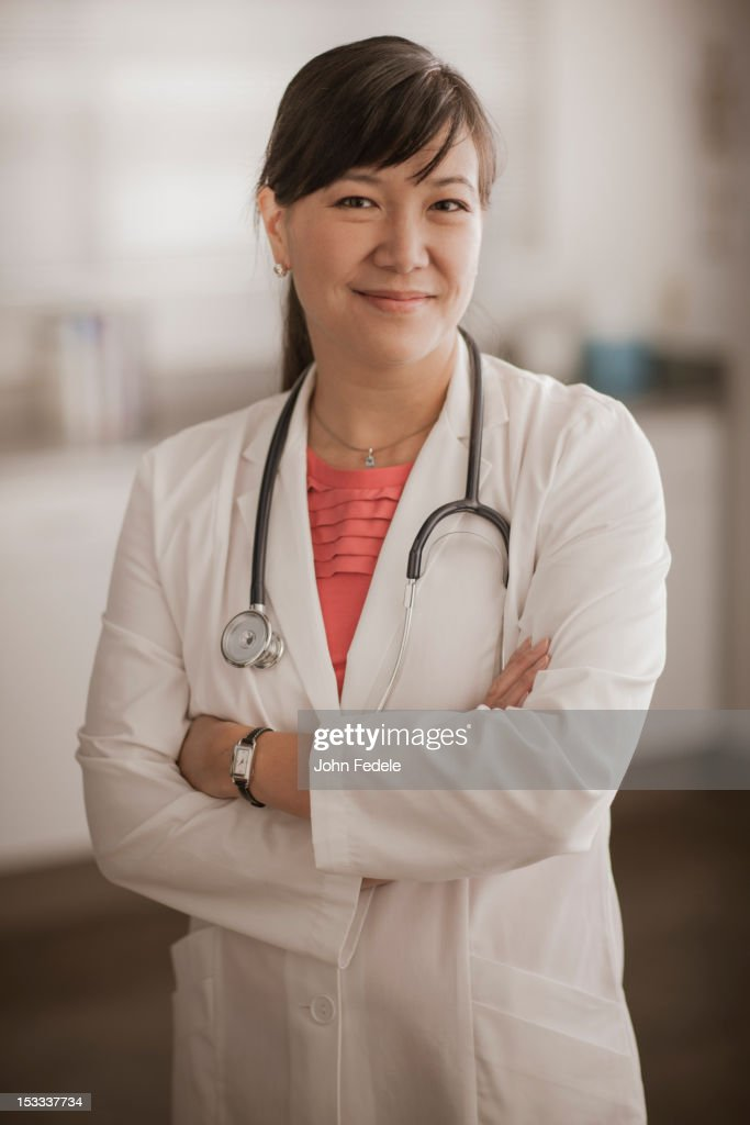 Smiling Chinese doctor : Stock Photo