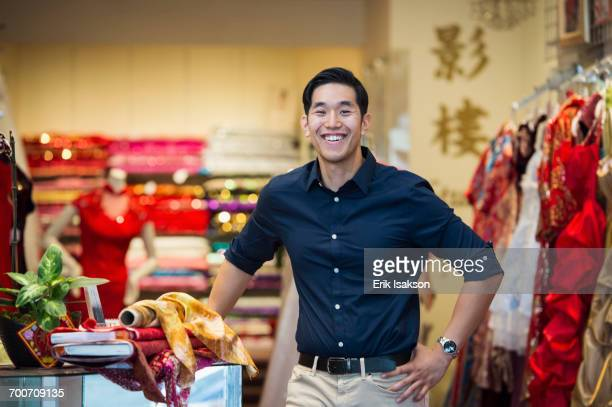 Smiling Chinese man posing in store