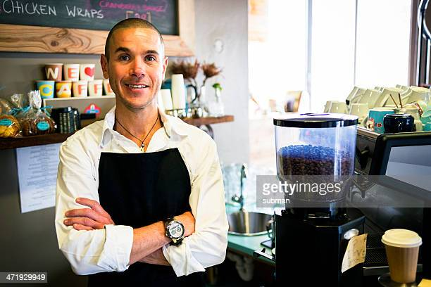 Smiling Coffee Shop Owner