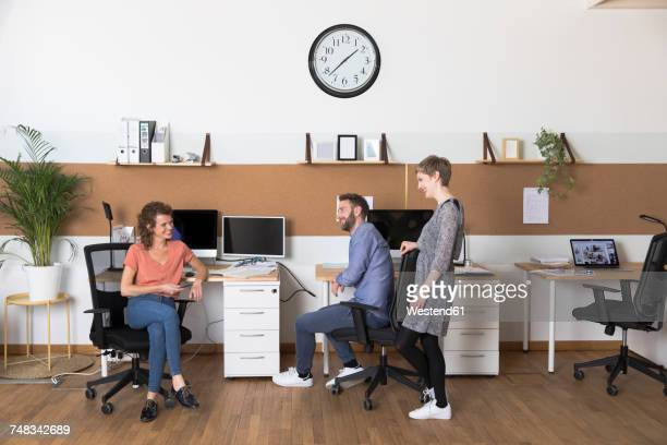Smiling colleagues in modern office
