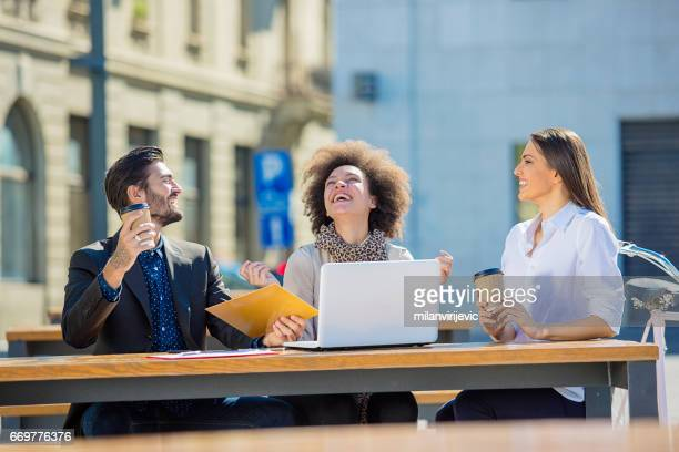 Smiling colleagues working outdoors