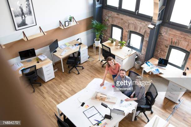 Smiling colleagues working together in modern office