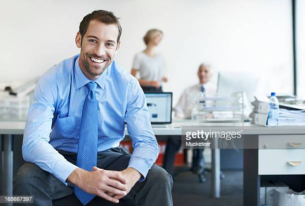 Smiling confident man in an office