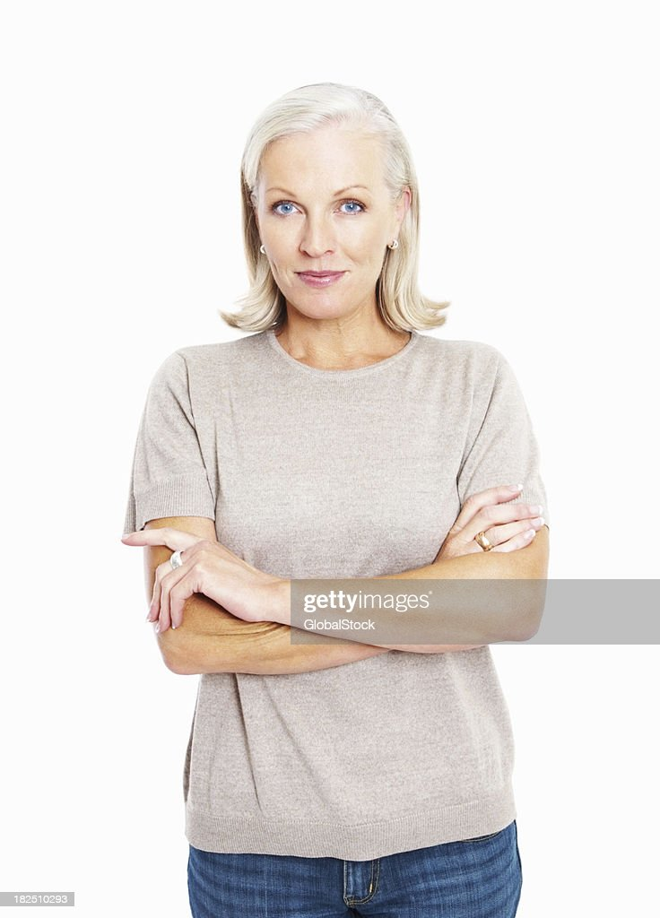 Smiling confident mature woman standing arms crossed against whi
