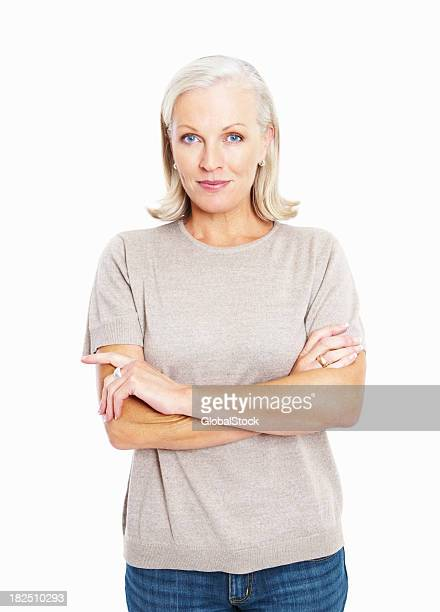 Smiling confident mature woman standing arms crossed against white