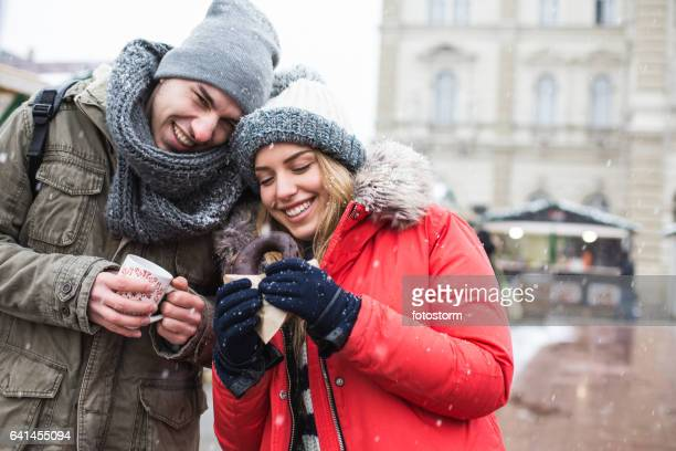 Smiling couple at Christmas market