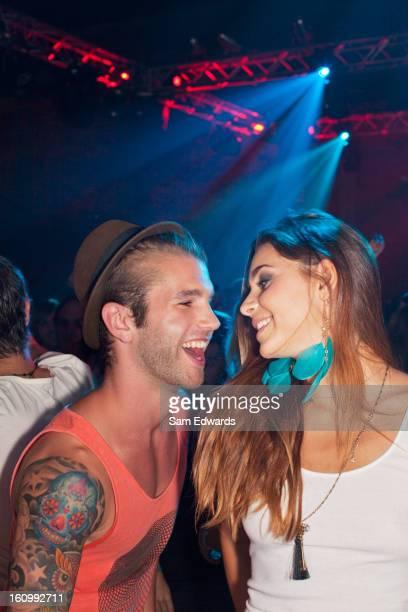 Smiling couple dancing at nightclub