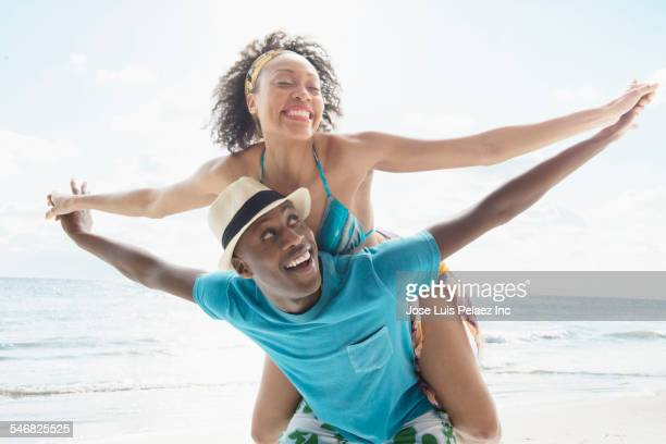 Smiling couple dancing on beach