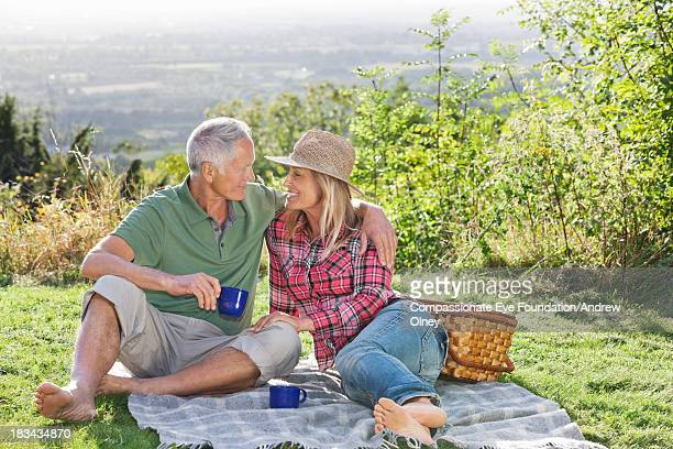 Smiling couple enjoying picnic