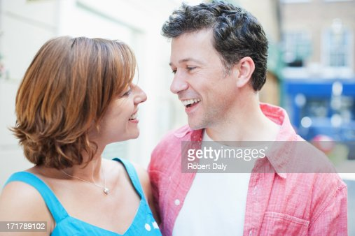 Smiling couple hugging outdoors : Stock Photo