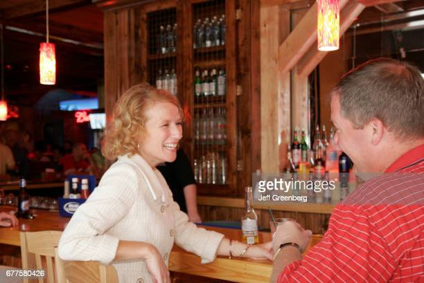 A smiling couple in Cadillac Ranch All American Bar and Grill