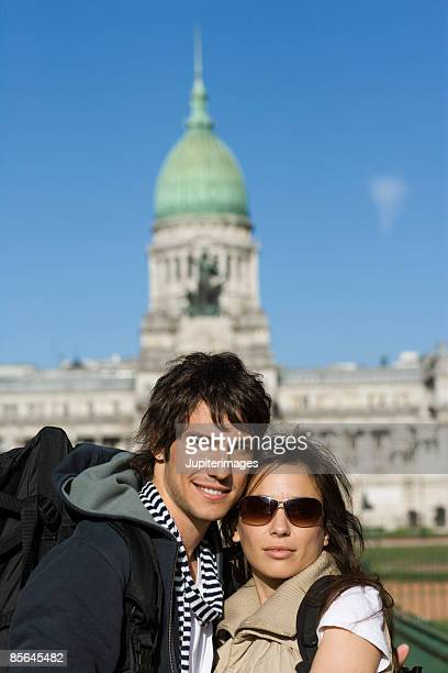 Smiling couple in front of monument