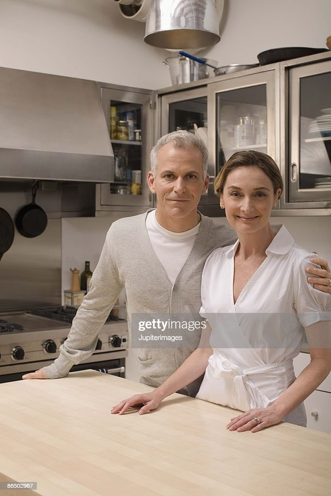 Smiling couple in kitchen : Stock Photo
