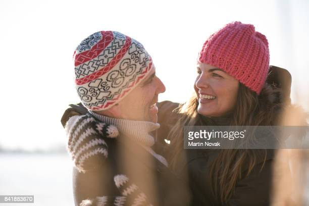 Smiling couple in love embracing outdoors