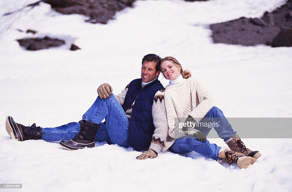 Smiling Couple in the Snow : Stock Photo