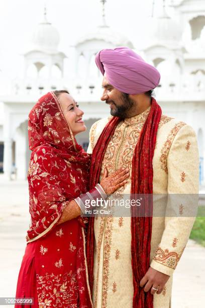 Smiling couple in traditional Indian clothing