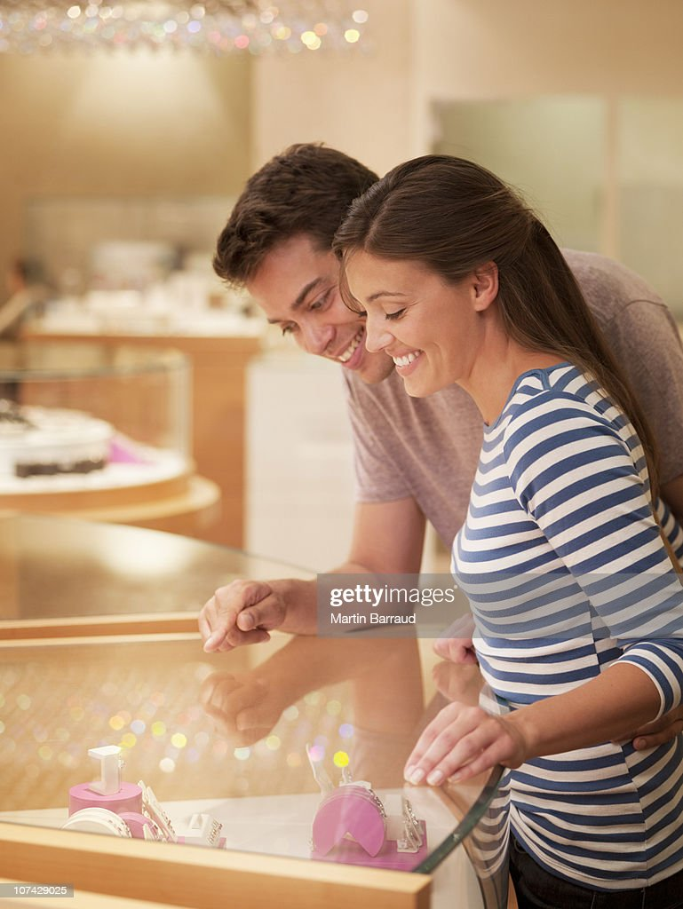 Smiling couple looking at jewelry case : Stock Photo