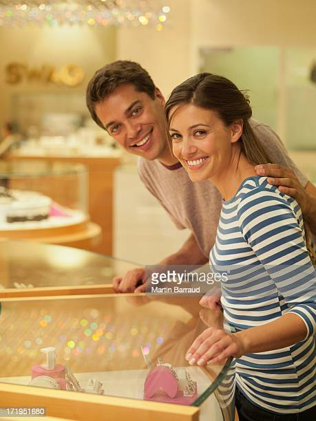 Smiling couple looking at jewelry case