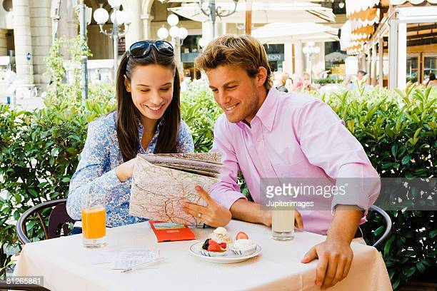 Smiling couple looking at map