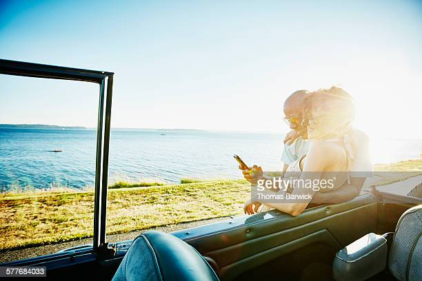 Smiling couple looking at smartphone