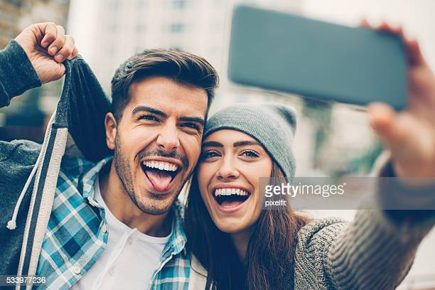 Smiling couple making selfie