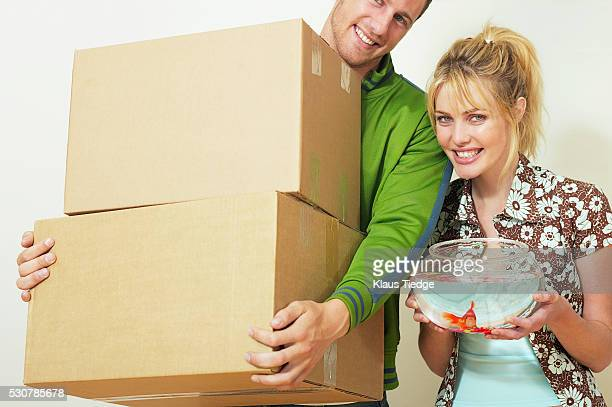 Smiling couple moving into new home