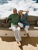 Smiling couple on boat in ocean