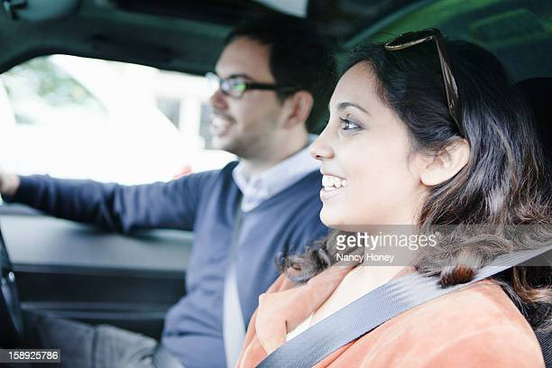 Smiling couple riding in car