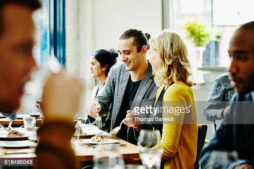 Smiling couple sharing plate of food in restaurant