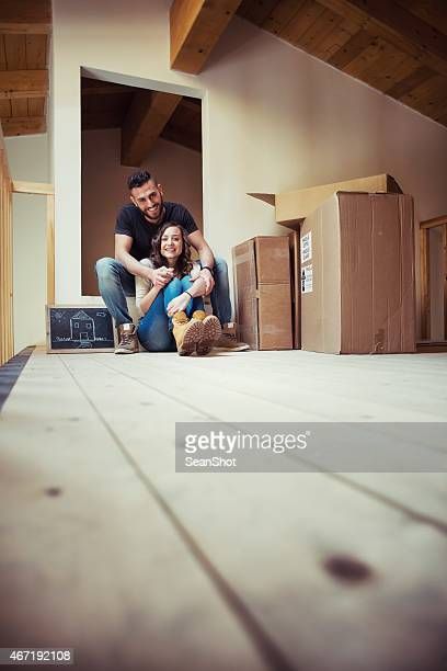 Smiling Couple Sitting in an Attic
