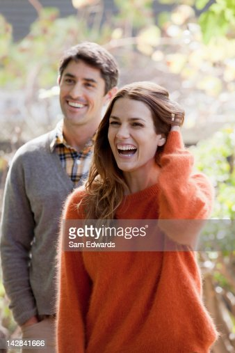 Smiling couple standing outdoors : Stock Photo